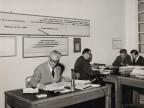 Giuseppe Merli al lavoro con in colleghi.